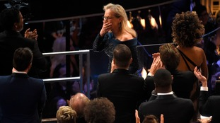 Streep looked emotional as the audience stood up.