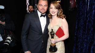 Emma Stone with her award - and the original best actress card.