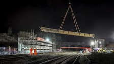Giant crane lifts six huge beams to build a new bridge in Northamptonshire