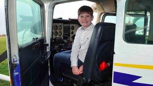 boy pilots plane alongside RAF veteran great-grandad