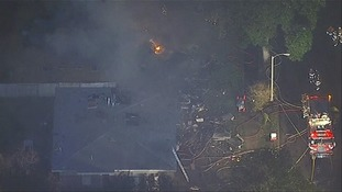 Plane crashes into two houses in California killing at least one