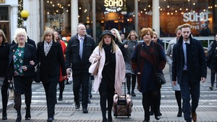 Relatives of those killed arrive at the Royal Courts of Justice.