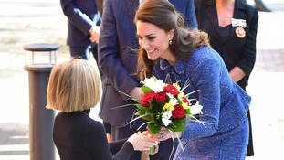 The Duchess meets a well-wisher at the Ronald McDonald House Evelina London