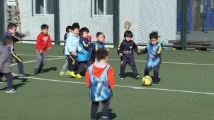 Children play football in China.