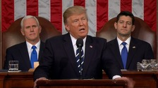 Donald Trump addresses Congress as Vice-President Mike Pence and Speaker of the US House of Representatives Paul Ryan look on.