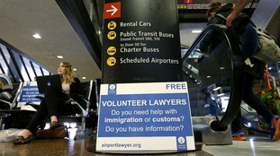 Volunteer lawyers prepare for Trump's new travel ban.