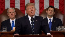 Trump addresses Congress as Vice-President Mike Pence and Speaker of the US House of Representatives Paul Ryan look on.