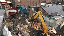 Demolition crew tears down former Coronation Street set