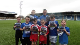 Derek Lyle and Stephen Dobbie with kids from the QOS's Saturday club