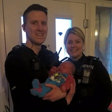In the line of duty: police officers stop to help deliver baby