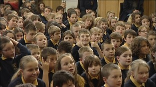 Pupils listening to Olympic Medalist Anna Watkins at her old school