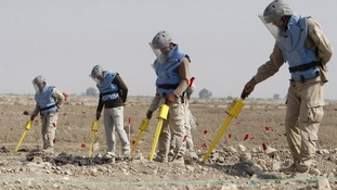 Members of the Iraqi Mine and Unexploded Ordnance Clearance Organization (IMCO) work to find mines in the Shatt-al-Arab district
