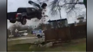 Watch: Pickup truck flies 20ft through the air in dramatic police chase