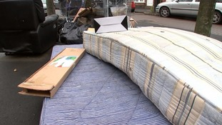 Mattresses and boxes dumped on a street in Manchester.