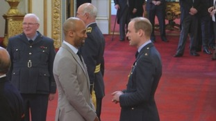 Newcastle Eagles head coach Fab Flournoy picks up his MBE from Prince William