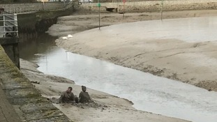 Sticky situation as couple get stuck in the mud after falling into river