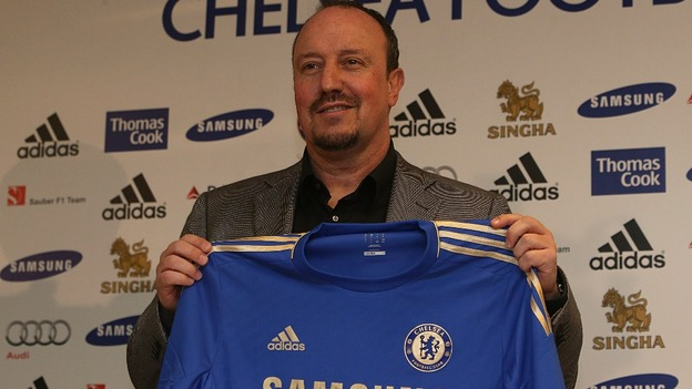 Rafa Benitez pictured with a Chelsea shirt at Stamford Bridge