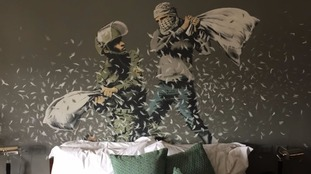 Banksy's artwork features in all of the rooms, including this bedroom mural