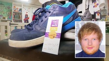 Shoes and shirts worn by Ed Sheeran have raised £1,000 for a Suffolk charity shop.