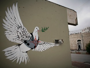 Banksy's famous dove in a flak jacket, seen in the West Bank in 2007