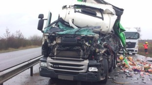 A lorry driver suffered minor injuries but needed cutting from his cab after a crash with another truck.
