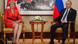Theresa May and Russian President Vladimir Putin