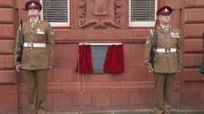 Soldiers guard the new memorial.