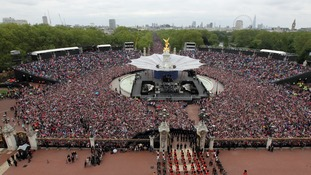 Crowds watch the Royal family from the Mall in 2012