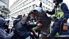Police contain demonstrators as far right and anti-fascist campaigners protest in Bristol city centre.