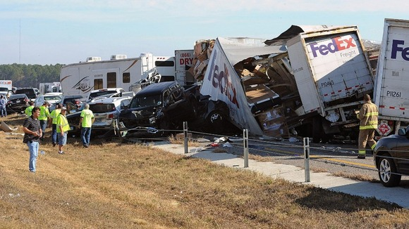 Cars and lorries stack on top of each other at the crash site