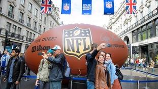 NFL fans take selfies on Regent Street.