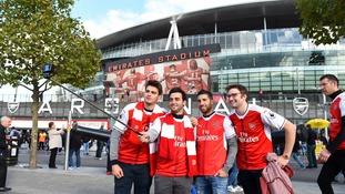 Arsenal fans take selfie outside the Emirates Stadium.