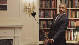 Barack Obama took pictures on a selfie stick in the Oval office in 2015.