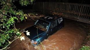 Car stuck under bridge