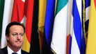 David Cameron, in front on some EU flags