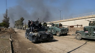 Iraqi security forces advance during fighting in Mosul.