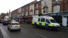 The man fell from a flat window in Stratford Road in Birmingham.