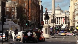 Whitehall closed because a naked guy has mounted a statue.