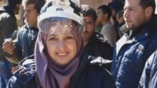 Menal Abazid wearing one of the iconic white helmets