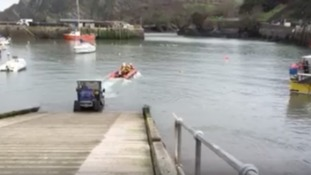 Father and son plucked from sea after dog rescue attempt