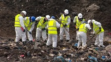 Specially trained police search the landfill site at Milton