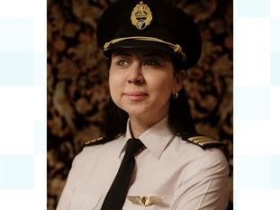 The first Egyptian female pilot to fly the Boeing 777-333, Magda Malek, sits for a photograph at her home