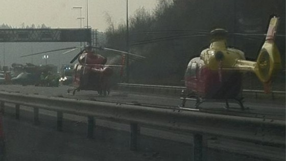Two air ambulances land at the scene of the crash.