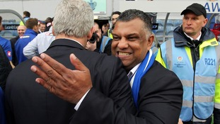 QPR chairman Tony Fernandes hugs his former manager Mark Hughes after the club escaped relegation last season.