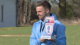 Stevenage striker Matty Godden shows off the EFL League Two Player of the Month award for February.
