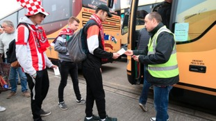 Lincoln City fans boarding the coach