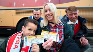 Showing off their tickets before boarding the coach at Sincil Bank