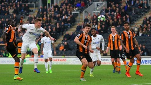 Alfie Mawson scores his side's only goal of the game at the KCOM stadium