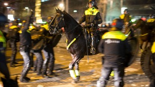 A riot police officer on horseback