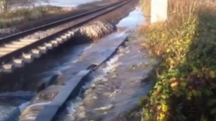 Flood waters by the side of a railway line near Axminster